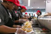 MOOYAH Houma Team Members Building Burgers